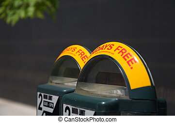 Parking Meters in Downtown Denver - Two parking meters stand...