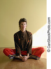 Serious Senior Yogini - Serious senior woman in the yoga...
