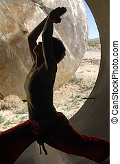 Inner Infinity - Woman in yoga pose inside of a large...