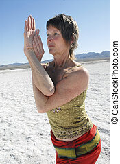 Eagle Woman - Woman in yoga pose outdoors in the desert with...