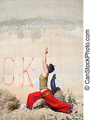 OK Warrior 1 - Woman in the yoga pose warrior 1, outdoors...