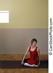Yoga Studio - Senior Woman in yoga posture inside a yoga...