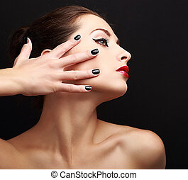 Sexy makeup woman with black nails on face. Woman profile...