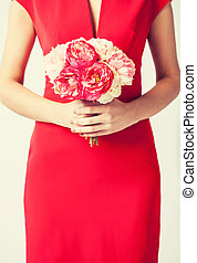 woman hands with bouquet of flowers - close up of woman...