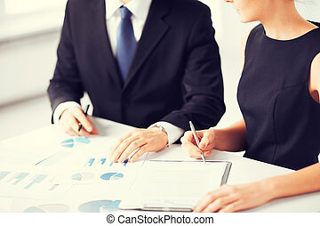 business team on meeting discussing graphics - picture of...