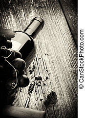 Bottle of red wine with fresh grape and corkscrew. Black and...