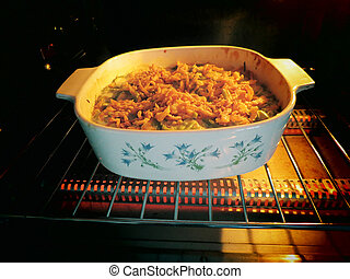 Green Bean Casserole - A green bean casserole cooking in an...