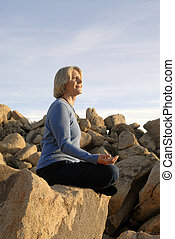 Meditation Woman - Woman in yoga meditiation pose outdoors...