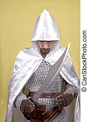 assassin - a white medioeval assassin in the yellow...