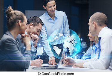 smiling female boss talking to business team - global...