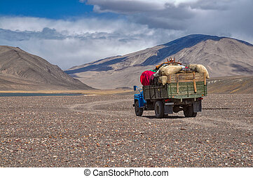 Lorry in Tajikistan - Truck loaded with goods on the road in...