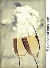 Celebrating with champagne - Two glasses of champagne over...