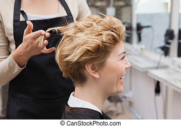 Customer getting her hair styled at work