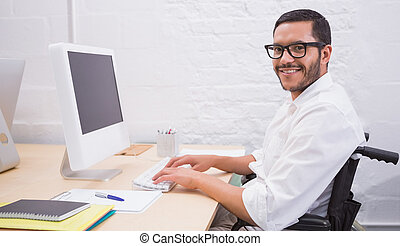 Businessman using computer - Portrait of young businessman...