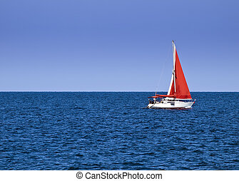 Yachting - Yacht with a red sail offering crisp contrast...