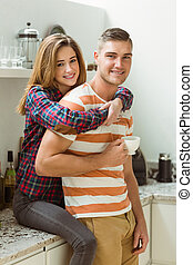 Cute couple spending time together at home in the kitchen