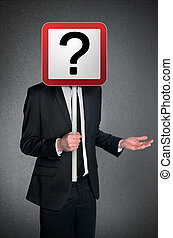 Business man confusion - Business man holding question mark...