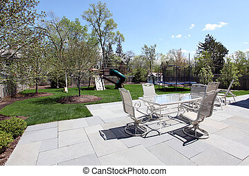 Patio and back yard of suburban home