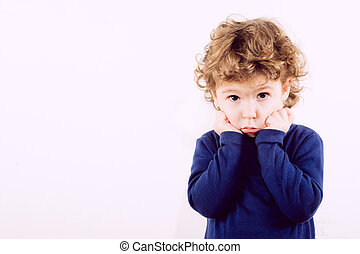 Portrait of worried child on white background