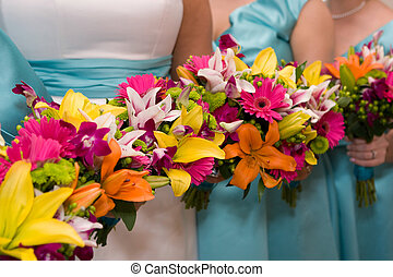 Bridal Flowers - The bride and bridesmaids hold their...
