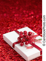 christmas gift - white color gift box on red background