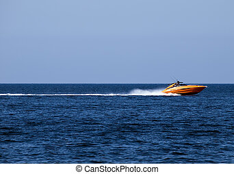 Speedboat - Orange speedboat speeding along the...
