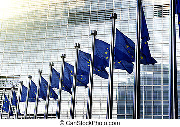 EU flags in front of European Commission in Brussels,...