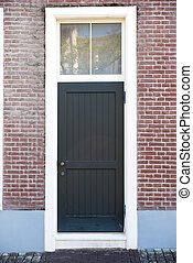 Vintage door in front of the house - Vintage black door in...