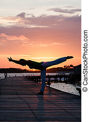 Yoga practise during sunset