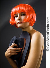 Naked woman with hat - Sexy young woman with color hair...