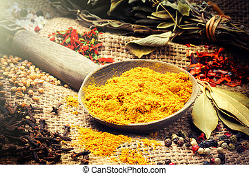 Colorful mix of various spices on burlap background