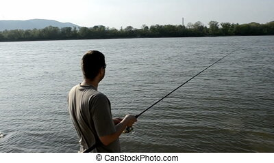 Man fishing outdoors with new fishing rod