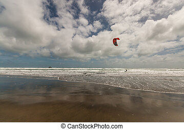 kite surfer on beach in New Zealand