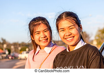 Young Girls - Charming girls Smile faces in front of an car