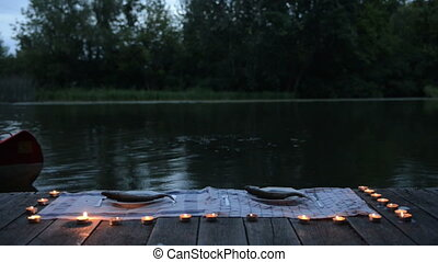Two man with axe and torch moving on canoe footage