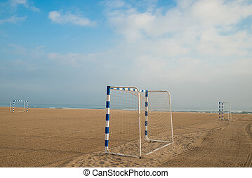 Beach soccer goals on a sunny sandy beach
