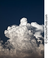 Cumulus and Lenticular - Towering detailed cumulus cloud...