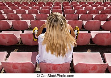 Female basketball player waiting for a match - Teenage blond...