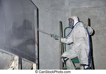painting the coal hopper - A trademan uses an airless spray...