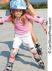 inline rollerblade child - child wearing helmet and...