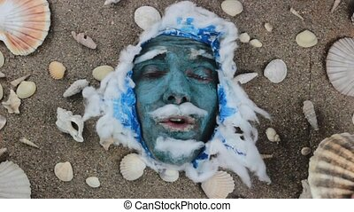 blue sea man scallop - funny blue man face with seashells...