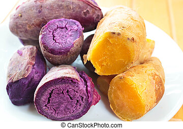 A steamed sweet potato or cooked yams. - steamed sweet...