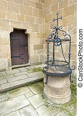 water well and wood door