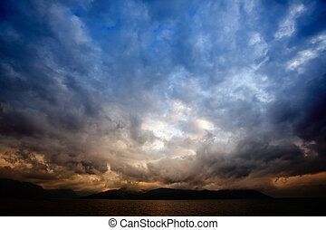 Storm Clouds - A brewing storm on an ocean sunset