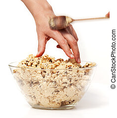 Sneak Cookie Dough - A hand reaching for cookie dough and...