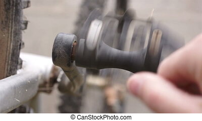 Fixing a Bicycle Pedal Spinning - Man spins the pedals by...