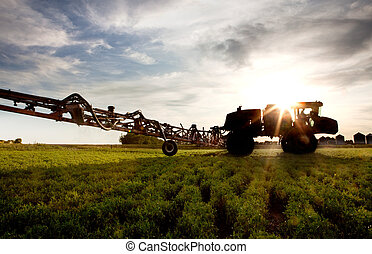 High Clearance Sprayer - A silhouette of a high clearance...