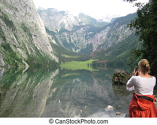 Photographer in the Mountains - this picture shows a female...