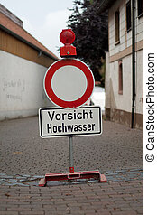 German sign that says caution flood - German sign that means...