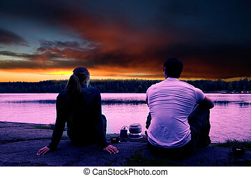 Camping Sunset - A couple watching the sunset while camping...